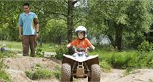 Driving a mini quad at Center Parcs Bispinger Heide